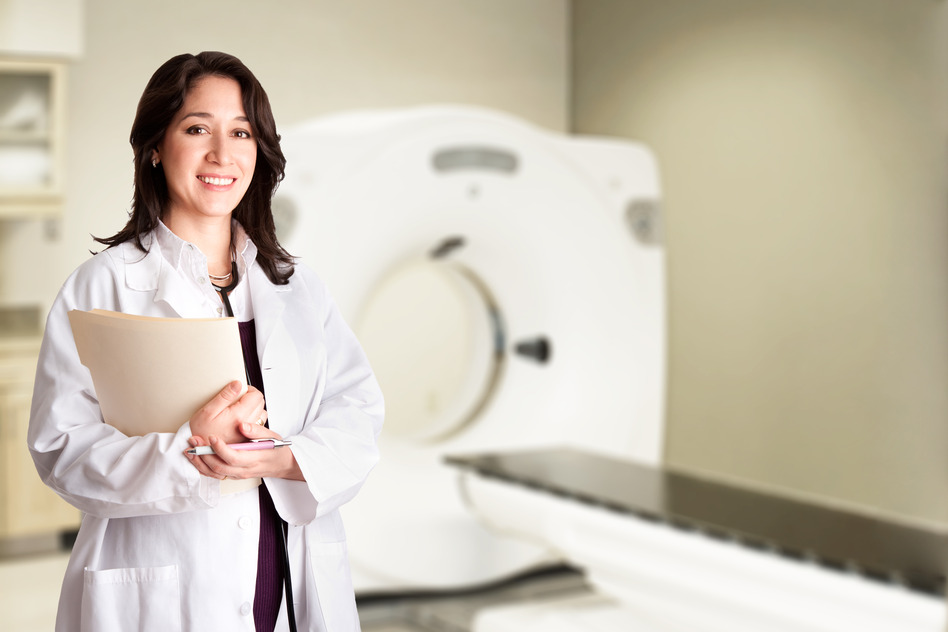 photodune-520125-female-doctor-radiologist-at-ct-cat-scan-with-chart-s